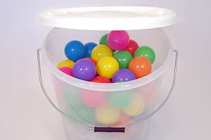 See through container (plastic balls for display purposes only).